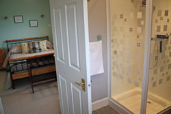 The comfortable double room and en-suite shower